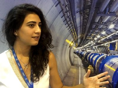 Farah Hariri in front of the Large Hadron Collider.