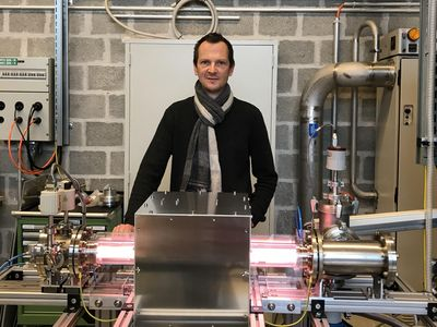 picture of Philippe Guittienne in front of his helicon plasma source.