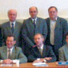"The Slovakian ""Kick-Off"" Meeting: Standing from left to right; J. Skalny (CU), F. G.m.ry (IEE), G. Farkas (SUT), P. Ballo (SUT), J. Breza (Faculty of Electrical Engineering and Information Technology, SUT), V. Slugen (SUT), P. Mach (CU), S. Booth (European Commission), B. Ecker (VUJE), F. Dubeck (IEE), E. Rille (European Commission). Seated from left to right; J. Masarik (Vice-Dean for Research and Foreign Affairs, Faculty of Mathematics, Physics and Informatics, CU), Mrs. M. Cimbakova (Ministry of Education), B. Green (European Commission), Y. Capouet (European Commission), S. Matejčik (CU), J. Bahna (VUJE)"
