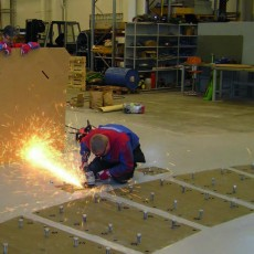 Cutting the bolts prior to the steel structure assembly. Photo: VTT Technical Research Centre