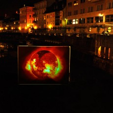 Fusion reflections in the Ljubljanica river | A large screen was positioned above Ljubljanica, river of Slovenia's capital Ljubljana, in the downtown, showing a slideshow about fusion and attracting many visitors to the itinerant Fusion Expo which was held between 10th and 20th March 2009