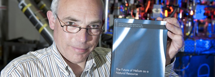 picture of Helium expert Richard Clarke show off his new book in the cryo plant at JET