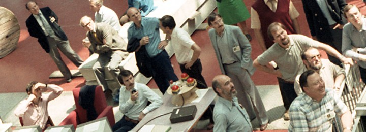 June 25th, 1983: First director of JET Hans-Otto Wüster (lower right) shows his pleasure at the success of JET's first plasma pulse, in the temporary control room in the Assembly Hall.