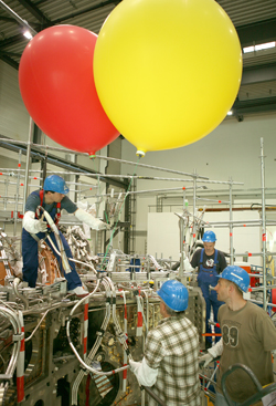 Helium-filled balloons for installation