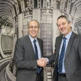 ITER's Director-General Bernard Bigot shakes hands with EUROfusion's Programme Manager, Tony Donné, in front of the great wall picture of JET's vessel at the Culham Centre for Fusion Energy (CCFE). Picture: © Copyright protected by United Kingdom Atomic Energy Authority