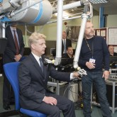 UK Science Minister Jo Johnson MP trying the JET Remote Handling system during his visit to Culham in May. Picture: © Copyright protected by United Kingdom Atomic Energy Authority