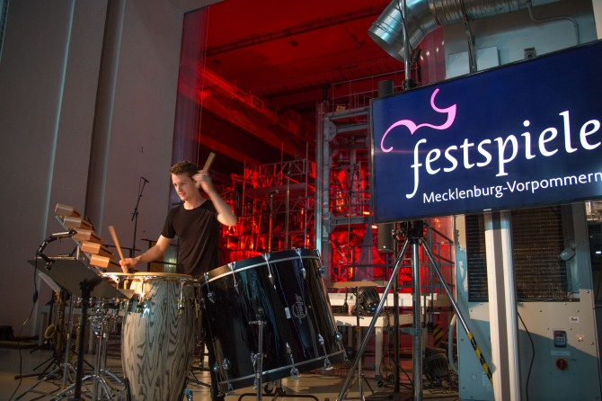 During a local music festival in September, Wendelstein 7-X became the stage for a classic concert. Drummer Richard Putz (picture) and other musicians performed music pieces inspired by light. Light show artist Gisela Meyer-Hahn illuminated the stellarator accordingly. Picture: IPP