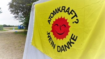 The famous banner of the anti-nuclear movement at a protest-camp against coal mining near Cologne, Germany in 2017. Is it in times of climate change still legitimate to reject nuclear fission and fusion?